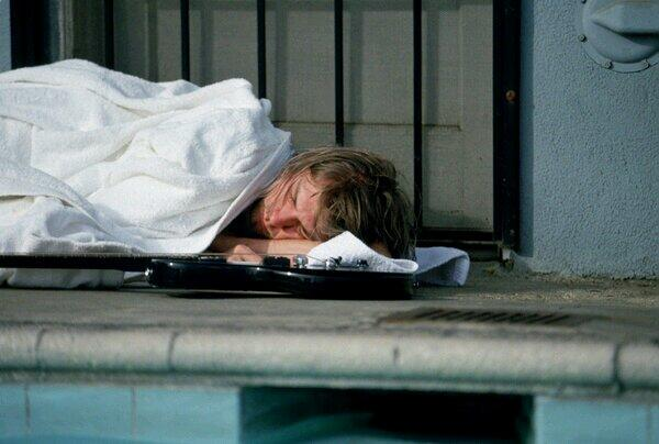 Kurt Cobain asleep during the 'Nevermind' photoshoot, 1991.