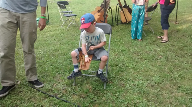 My son having fun at Todd Crowley's Traveling Musical Petting Zoo